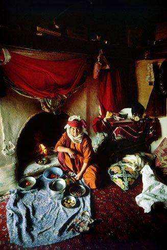 Ladies cooking in the tent... By Ara Güler