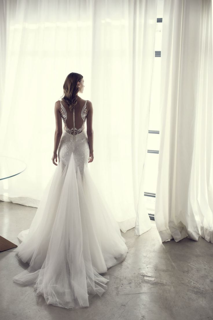 Interesting intricate backs on wedding gowns 10 for Angel wings wedding dress