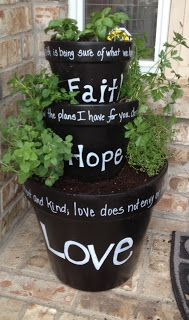 """I'm loving this """"Faith, Hope, Love"""" tiered planter pot. I saw a """"Home Sweet Home"""" version of this, too. The black planters are surprisingly elegant and makes the white words and green plants stand out. I think it's due to her lighter house and porch. I'm going to have to learn how I want to fill the planters though or if I should use a cachepot or use a saucer. Her blog has things she made that were from Pinterest... Interesting! Link is correct."""