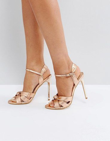 """Hollie Rose Gold Heeled Sandals by Office. """"""""Sandals by Office, Metallic faux-leather upper, Ankle-strap fastening, Peep-toe style, High stiletto heel, Wipe clean, Heel height: 10cm/4"""". After starting out as a concession displaying its products on old office furniture hence the n... #office #nudeshoes"""