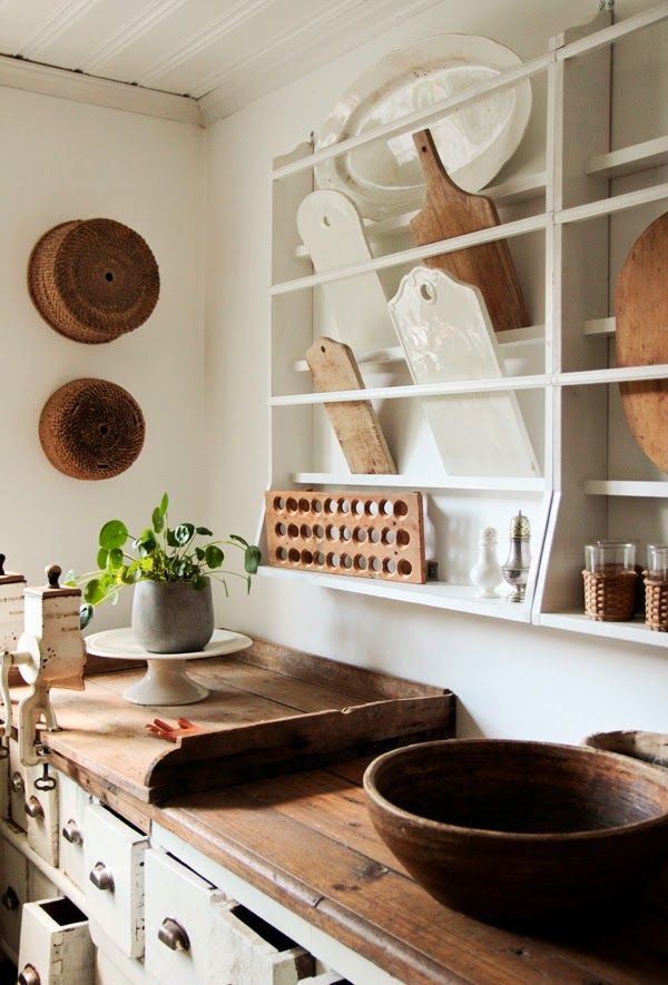 Beautiful open kitchen storage, perfect for a tiny home. Nice place for cutting boards.