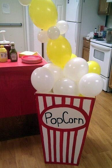 Wrap patio columns to look popcorn boxes and have balloon garlands above curtains
