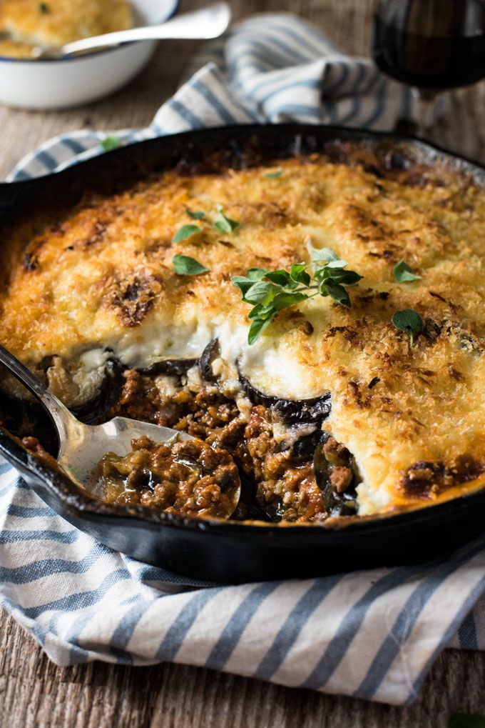 Traditional Greek Moussaka recipe - Layers of eggplant with beef in tomato sauce and topped with Béchamel Sauce. Authentic, classic Greek food! www.recipetineats.com
