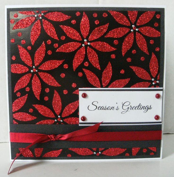 Handmade Christmas card. Imagination Crafts' Sparkle Medium, Poinsettia stencil on black satin card.