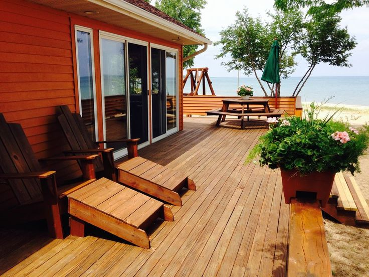 Large Deck With Picnic Table, Umbrella, Adirondack Chairs.