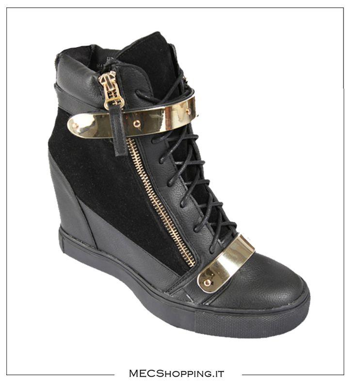 http://www.mecshopping.it/shop/scarpe/scarpe-donna/casual/stivaletto-con-zeppa.html