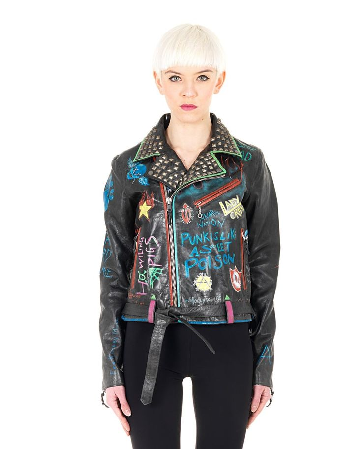 HTC LEATHER STUDDED JACKET Black leather studded jacket fully hand-painted V-neck with studs long sleeves with zippered cuffs two front zippered pockets belt loops with belt cross zipper closure 100% Leather  Lining: 100%
