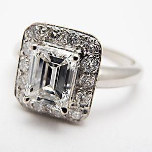VINTAGE HALO  EMERALD CUT DIAMOND ENGAGEMENT RING