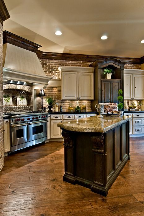 I love the wood flooring in this kitchen.  Also love the mix of light and dark cabinets and stone countertop.