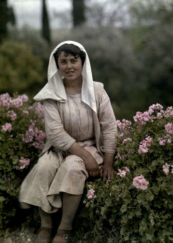 Young woman sitting in a garden of flowers, Corfu; 1920's; Images by Maynard Owen Williams / Wilhelm Tobien;  Source: National Geographic Stock