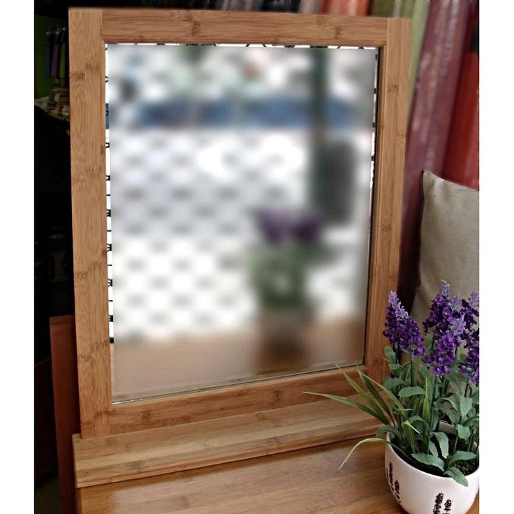 Un sencillo y elegante espejo de bambú para pared o aparador