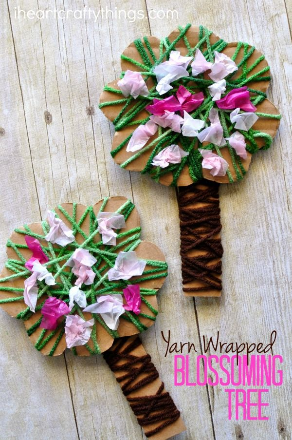 Celebrate the beautiful season of spring by making this pretty yarn wrapped blossoming spring tree craft. It is a great spring kids craft and the yarn wrapping and crunching tissue paper squares helps to work those important fine motor skills.