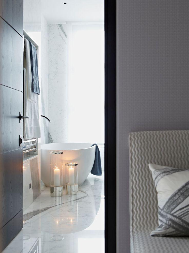 View into Trevor Square bathroom | inset towel rails | marble | free-standing bath | luxury