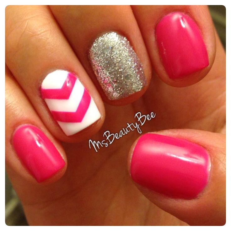 Hot Pink & Chevron Nails. Gelish - Carnival Hangover (Hot Pink), Arctic Freeze (White) & Martha Stewart Silver Glitter scrubbed in topped with Gelish - Am I Making You Gelish? (Silver glitter polish) I used vinyl tape to do the chevron accent.