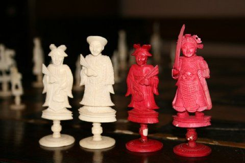The modern game of #chess we play in the United States was not introduced to #China until the 19th century. This is an example of a 19th century stained Chinese chess set. The set is made of delicately carved #ivory on rounded pedestal bases. Half of the set is stained red.