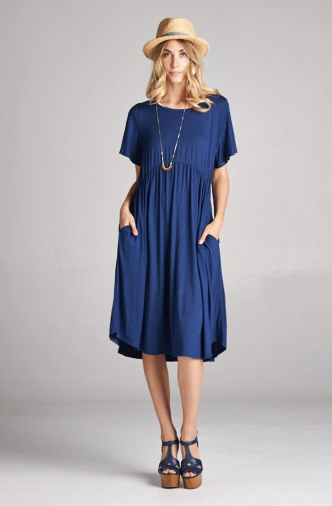 """Loose fitting, knee-length dress with pockets Sizing: S: 2-6 / M: 8-12 / L: 14-18 Length: S: 40"""" / M: 41"""" / L: 42"""" 96% Rayon / 4% Spandex"""