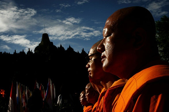 Buddhist monks meditate at Borobudur temple in central Java. Photograph: Ulet Ifansasti/Getty Images