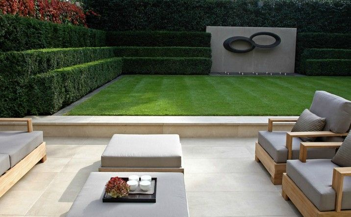 Contemorary garden space. More interest could be created with pyramid box in the corners and elegant planters along the low wall.