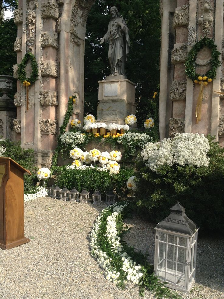 Flowers, garlands and lemons decorating the altar area