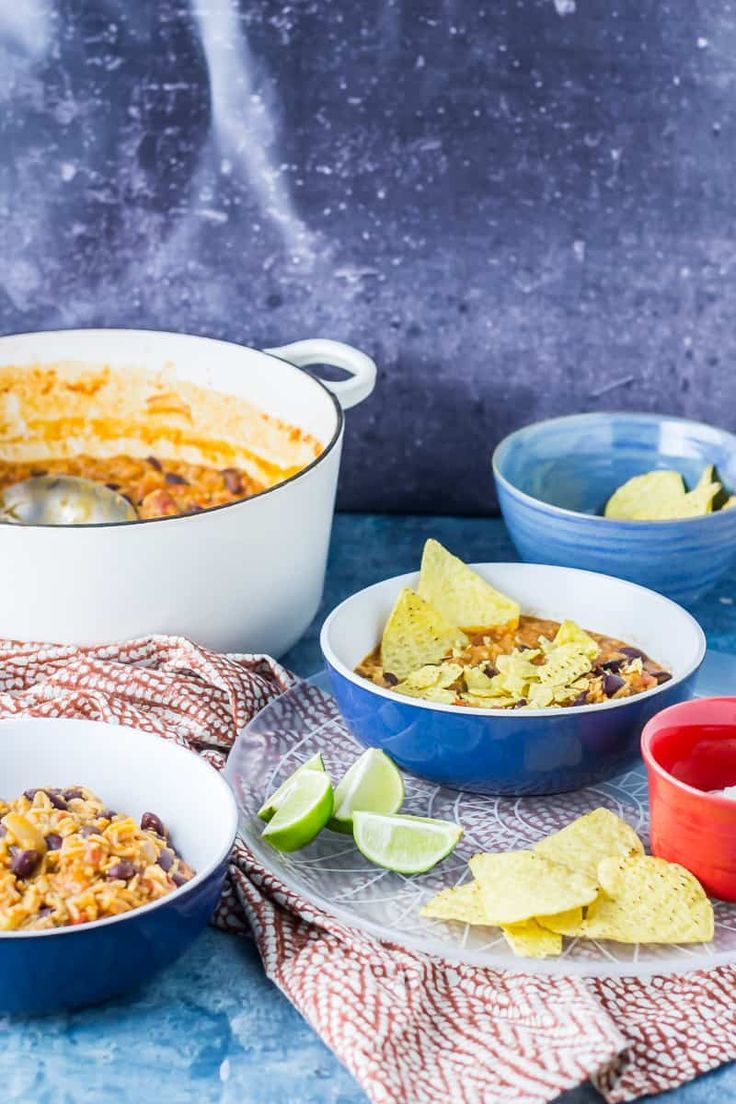 Mexican Rice & Vegetable Stew. Cheesy Mexican rice and vegetable tortilla stew is a tasty vegetarian weeknight dinner packed with beans, vegetables and spices! #mexican #rice #stew #vegetarian