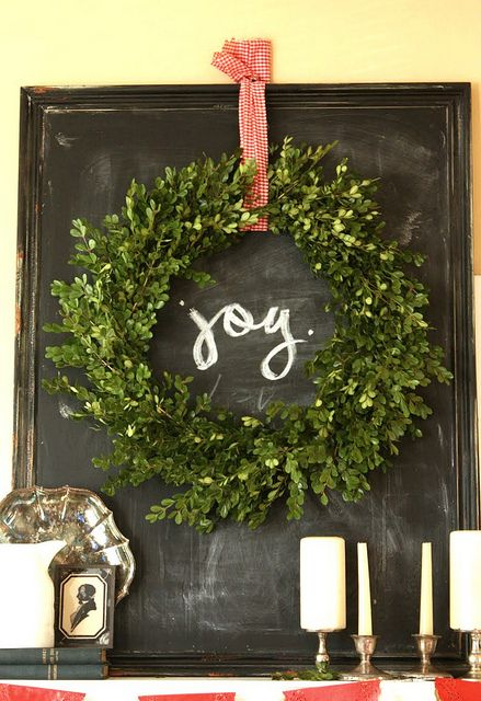 wreath on a chalkboard. Could use all those large single pane window frames for the chalkboards.