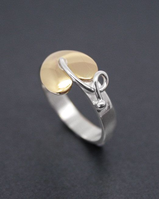 Silver ring with brass heart leaf