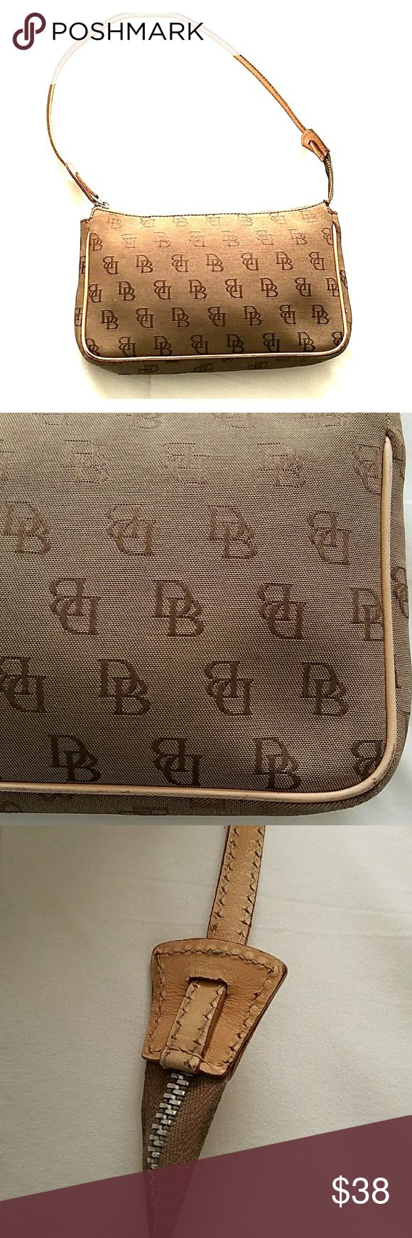 Dooney and Bourke Signature Continental Cute little bag, perfect for a night out or when you don't need to take a lot with you. In good condition, a little worn on the corner as pictured. Dooney & Bourke Bags Mini Bags