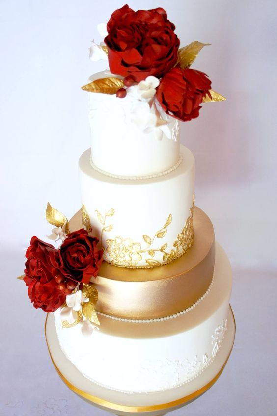 Romantic red flower topped gold and white wedding cake; Featured Cake: Sugarbelle Cakery