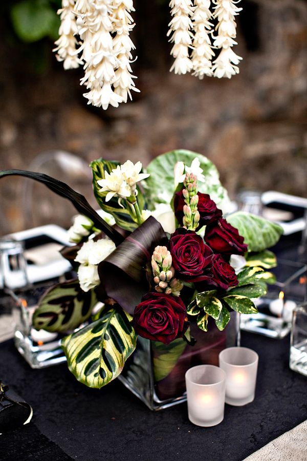 """Original pinner said: """"Beautiful deep red, green and white centerpiece for Maui wedding, photo by top wedding photographer Joy Marie Photography 