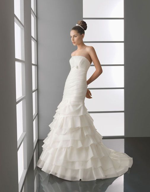 Strapless dropped waist trumpet / mermaid organza wedding dress