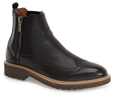 $150, Black Leather Chelsea Boots: Calvin Klein Jeans Calvin Klein Terris Brogue Chelsea Boot. Sold by Nordstrom. Click for more info: https://lookastic.com/men/shop_items/335918/redirect
