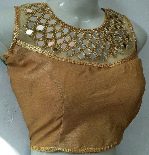 Beautiful golden banglori silk and soft net with cotton lining designer blouse.Blouse with hand embroidery mirror work.<br>Blouse Size is 38 (Margin is Max up to 42)  Blouse Type is fully Stitched. 17 July 2017