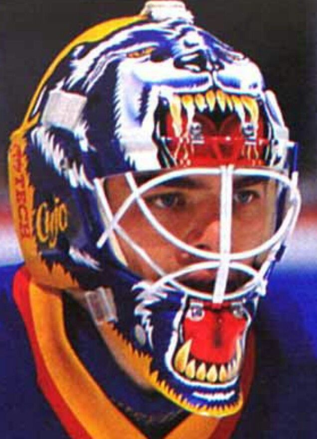 """Curtis """"Cujo"""" Joseph St. Louis Blues mask. One of the best mask designs ever"""