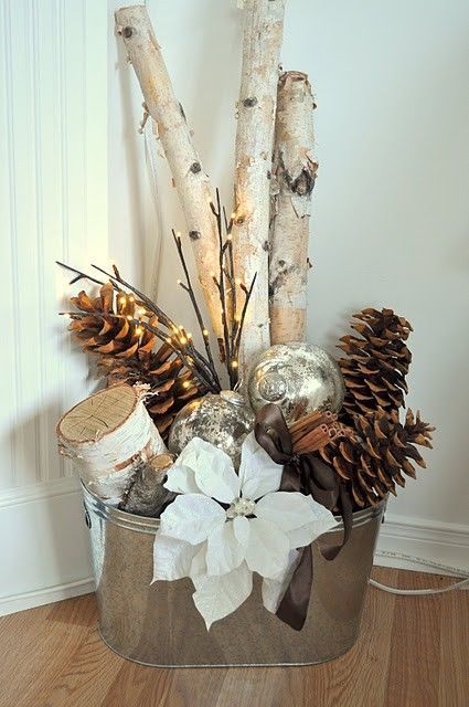 Birch Logs, Pine Cones, White Poinsettia & Bulbs In A Bucket.