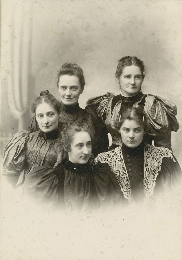 Studio portrait of Emily Carr and her sisters. Clockwise from left: Lizzie, Edith, Clara, Emily, and Alice. Photograph by Skene Lowe, c. 1895.