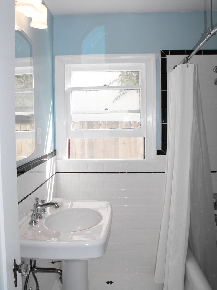 from an outdated pink bathroom to a classic bathroom