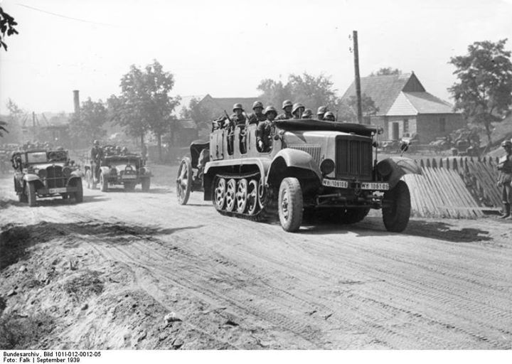 German SdKfz. 6 half-track vehicle towing a howitzer and carrying troops in Poland September 1939. Credit: Bundesarchiv Bild 101I-012-0012-05 Falk.