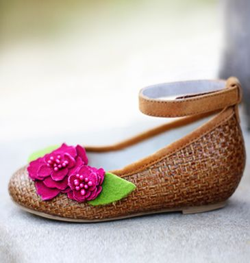 "Brielle    These shoes were designed by the prompting of my daughter, who repeated asked for a shoe with ""just a little bit of heel.""  The slight wedge paired with glazed raffia and magenta flowers makes for a versatile pair of summer kicks.  Padded insole and eco-friendly soles."