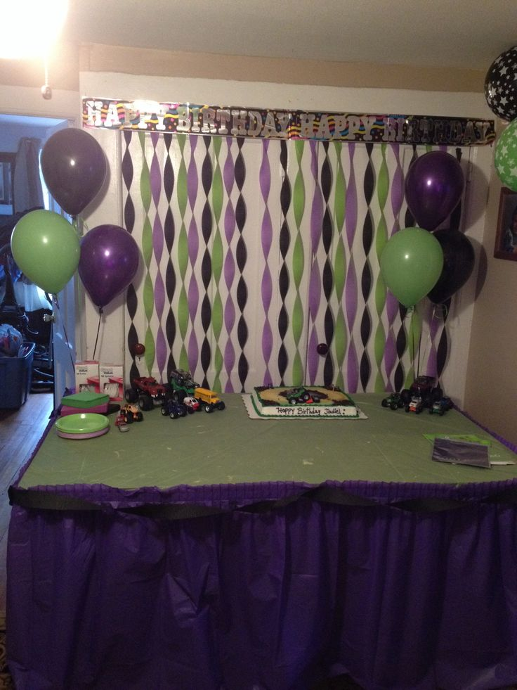 Jadiels 4th birthday monster jam/grave digger themed. Cake table bank drop.