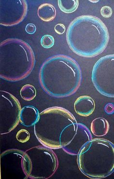 prachtige bellen, eerst stempelen op papier en daarna met pastels (of krijt) de randen inkleuren. vergeet het witte lichtstreepje niet waardoor het echt op bellen gaat lijken