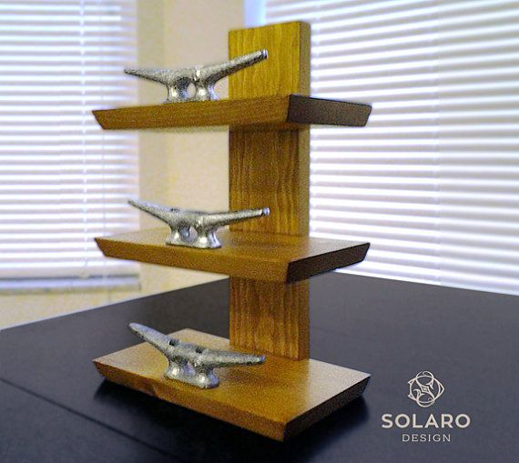 Nautical-themed standing wine rack with 6 galvanized dock cleats to secure the bottles in place. Best for wine you wish to preserve while displaying