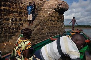 FTA: Joe Penney: People leave the colonial-era dock on the island of Bolama