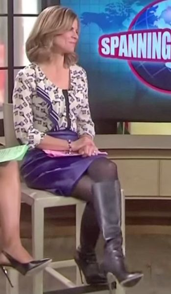 Natalie Morales in leather skirt and knee high boots ...