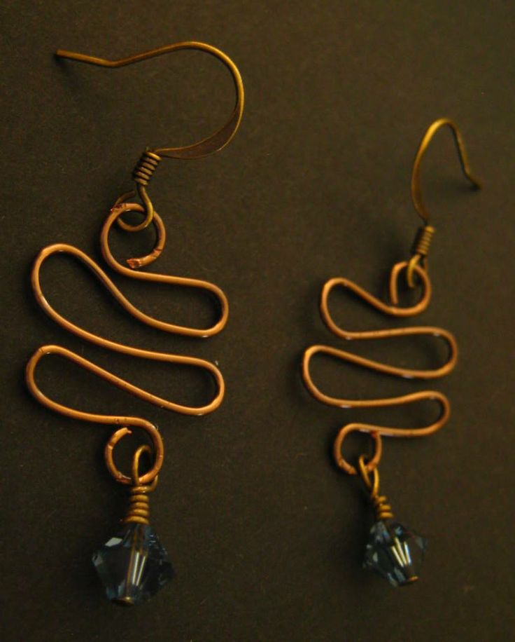 Twisted Wire Earrings with Deep Blue Bicone Stones - These unique earrings are a wonderful addition to your accessory wardrobe. The deep blue bicone stones compliment the antique bronze metal finish. Fishhook style earring hooks.  $1.99 available at http://www.beaddesignsbysandy.com/shop/clearance-items/