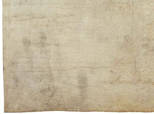 Indeed, there is a handprint in the bottom left corner of the Declaration of Independence. How it got there isn't known, but historians think that it was because it was handled so casually in the early days of the Republic.