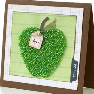 Add Texture to a Card with Beads  Design by Candi Gershon  Candi die-cut the apple from a heavyweight sheet of adhesive, then covered it with seed beads to create an apple with delicious texture. She completed the look with a metal stem and metal leaf.