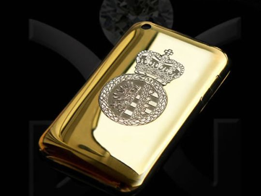 """The """"Golden Delicious,"""" an iPhone case that puts all the other ones to shame. It costs $110,000. It features a 1mm subshell of 18k gold, a carbon fiber inlay and 200 diamonds."""