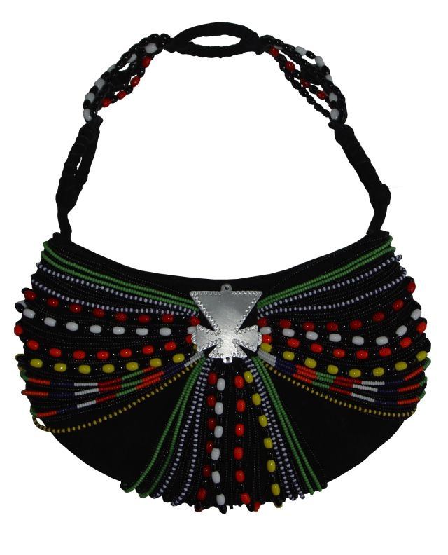 Maasai Evening Bag Classic with Cow Horn Embellishments. We Deliver Worldwide. Order now by writing to us on Facebook or e-mailing sales@annatrzebinski.com.  For further information about our products, studio and upcoming trunk shows please feel free to contact us.