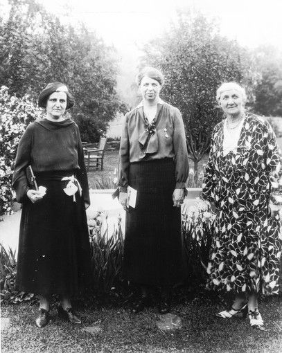 Ms. Henry Morgenthau Jr., from left, Eleanor Roosevelt and Jane Addams stand in a garden in 1929.