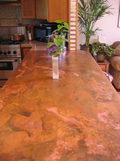 copper countertops - contact cement to particle board and sheet of copper.. fub on & fold over edge of counter.  staple underside. spray on 2 + coats sealent.